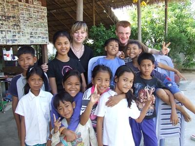 Volunteer with children in Cambodia