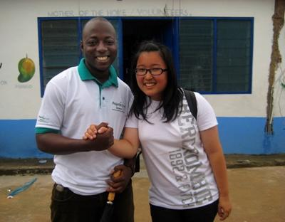 A volunteer posing with one of our staff members during his visit to her placement at a school in Ghana