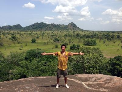 Volunteer at a mountain in his leisure time in Ghana