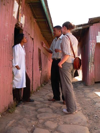 Volunteers with a local on the Journalism project in Africa