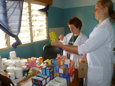 Projects Abroad Medicine interns wearing lab coats at a placement in Africa