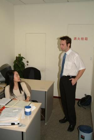 Male volunteer consults with local staff on a Law & Human Rights project in Asia
