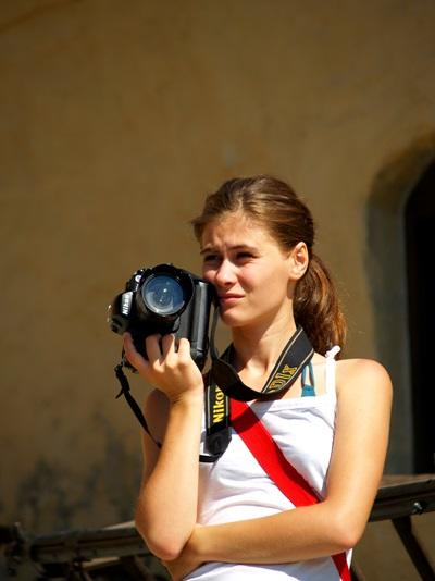 Journalism intern holding a camera on her project in Romania, Europe