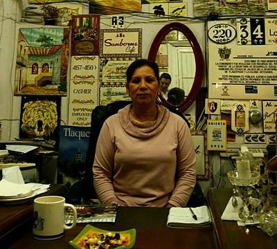 Women in her store on the Business project in Latin America