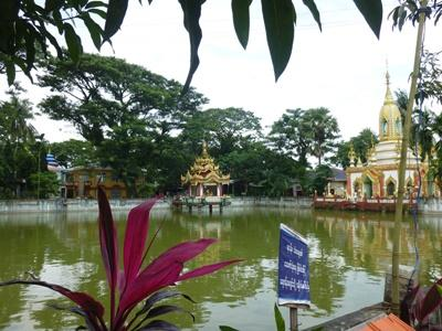 A beautiful scene at a lake and shrine at the local monastery in Dala, Myanmar.
