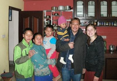 Projects Abroad volunteer at home with her local host family in Kathmandu, Nepal.