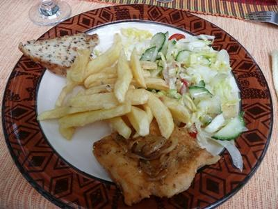 Volunteers enjoy a fish and chips meal in Cape Town