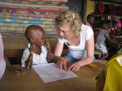 German volunteer plays with child on the Care project in Africa
