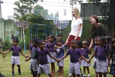 Volunteer with children on a Care project in Cambodia with Projects Abroad