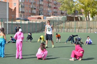 Volunteer with students coaching sports at a school in Asia