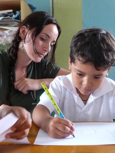 Progress of a child's writing skills is monitored by a volunteer for our Global Impact Database