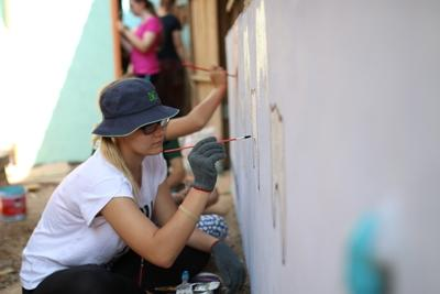 On her gap year volunteering abroad, this participant helped paint school murals in Cambodia