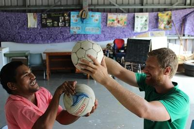 Projects Abroad intern works with a patient at his physical therapy project in Samoa.