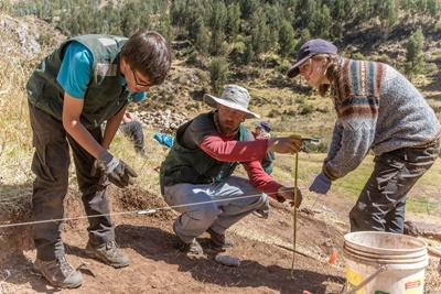 Projects Abroad volunteers on the Archaeology Project in Peru assist a staff member at an excavation site in Sacsayhuaman.