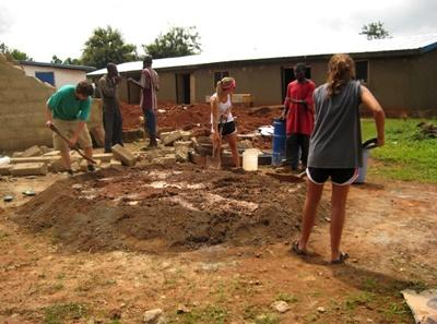 Volunteers dig a plot to construct a building on the Community Building project in Ghana