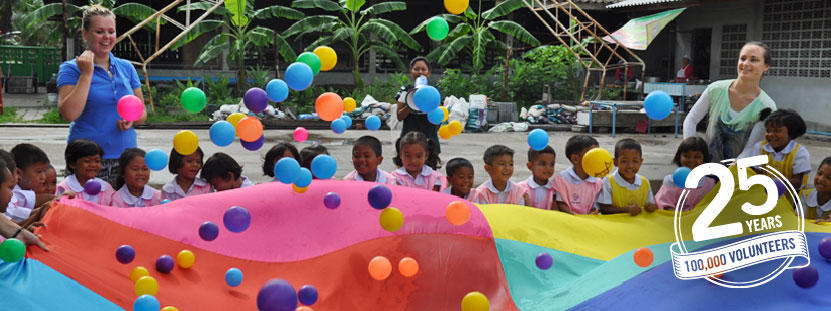 Two volunteers run an activity for children at a Care placement