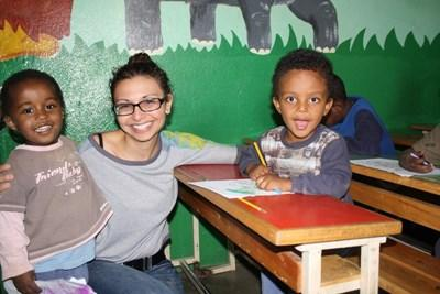 Volunteer doing an educational activity with kids in a childcare facility in Ethiopia, Africa