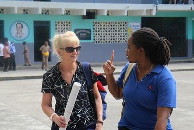 Projects Abroad Jamaica volunteer and staff member visit a school to present a workshop about HIV/AIDS.