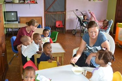 Projects Abroad volunteer assisting local children at her volunteering project in Jamaica