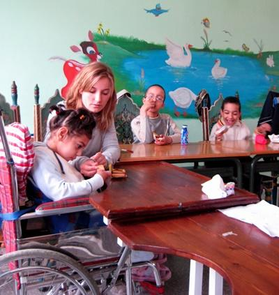 Volunteer with disabled children in Morocco