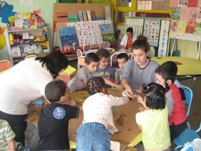 Volunteer in childcare center working on an activity with kids in Morocco