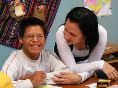 Female volunteer working in a special needs care center in Peru