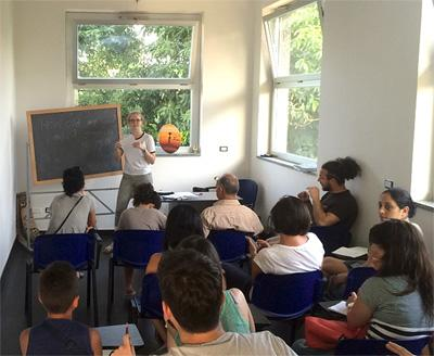Projects Abroad Refugee Project volunteer leads a class in Italy, Europe