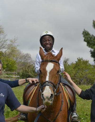 Local child participates in an equine therapy session at a centre in South Africa