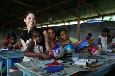 Volunteer with young girls in a care centre in Sri Lanka on the Care project