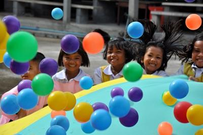 Thai children playing at Care project in Asia.
