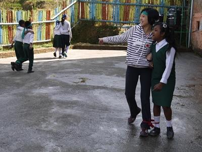 Projects Abroad Chinese New Year Special volunteer plays a game with young students in Nepal.