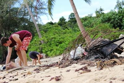 Projects Abroad Conservation volunteers assist with cleaning up a Cambodian beach.