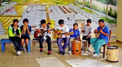 Kids in Bolivia create a band during a music lesson by a Performing Arts volunteer