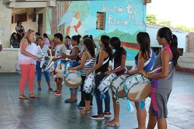 Ecuadorian teenagers are taught a music class by a Projects Abroad volunteer.