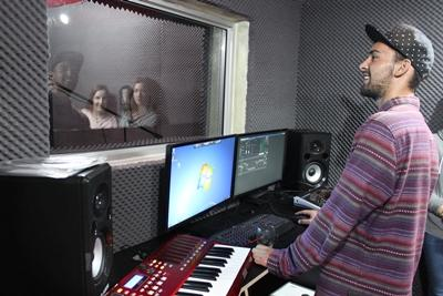 Projects Abroad Music Production volunteer works with artists recording vocals in South Africa.