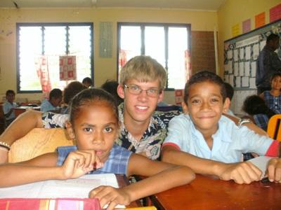 Volunteers with students in a school in Fiji