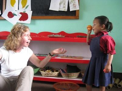 A child plays with a Projects Abroad volunteer at her school in Nepal