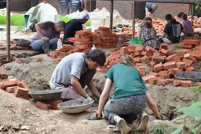 Projects Abroad Building Project volunteers at work at a school in Nepal, Asia