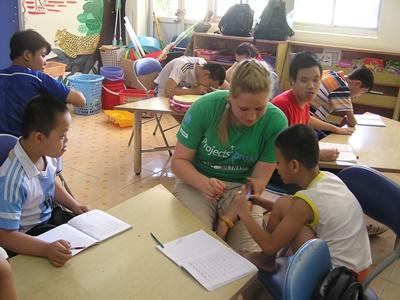 Projects Abroad Care & Community volunteer helps a special needs group at Friendship Village in Hanoi, Vietnam.