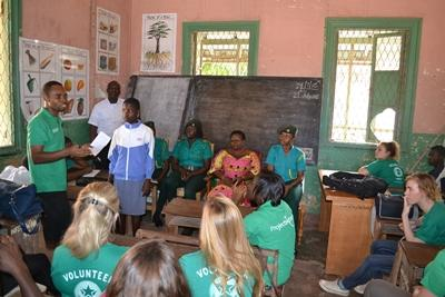 Projects Abroad volunteers and staff talk about preventing child trafficking at a school in Ghana, Africa.