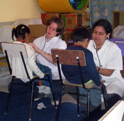 Teen volunteers in Bolivia do medical checkups in Bolivia