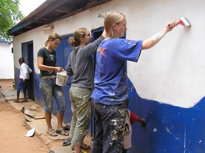 High School Volunteers painting the exterior of a school in Ghana, West Africa