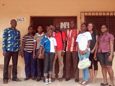 Projects Abroad intern with Togolese staff at her International Development placement in Togo, West Africa.