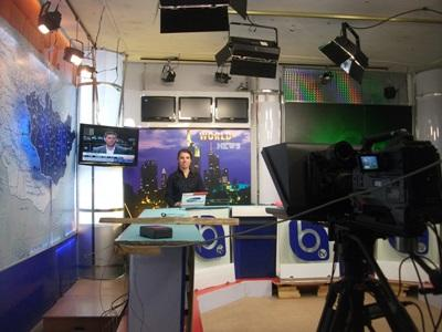 Journalism interns in Moldova present the news on a television broadcast
