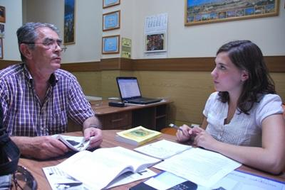 Volunteer works with staff at the journalism project in Romania