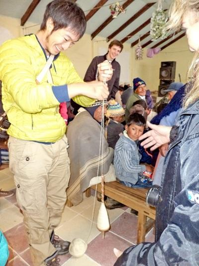 An Asian volunteer learns about local arts & crafts in Bolivia, South America.