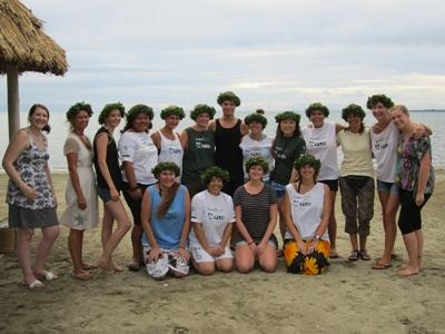A group of Projects Abroad volunteers take a photo on a beach in Fiji.