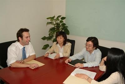 Intern on the Human Rights project in China works with Staff
