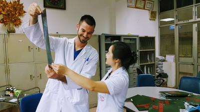 Interns examine an x-ray on their Medical volunteer Internship abroad