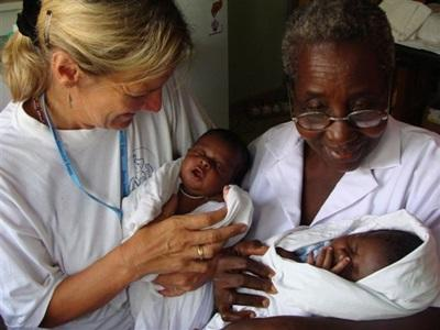 Volunteer and staff treat babies on the midwifery project in Ghana